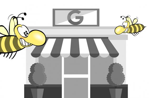 Geschäft mit G als Überschrift, Biene im Vordergrund